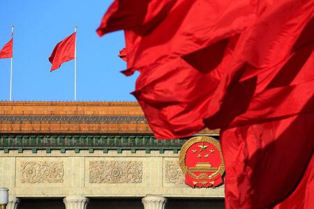 Red flags flutter outside the Great Hall of the People before the second plenary session of the CPPCC in Beijing