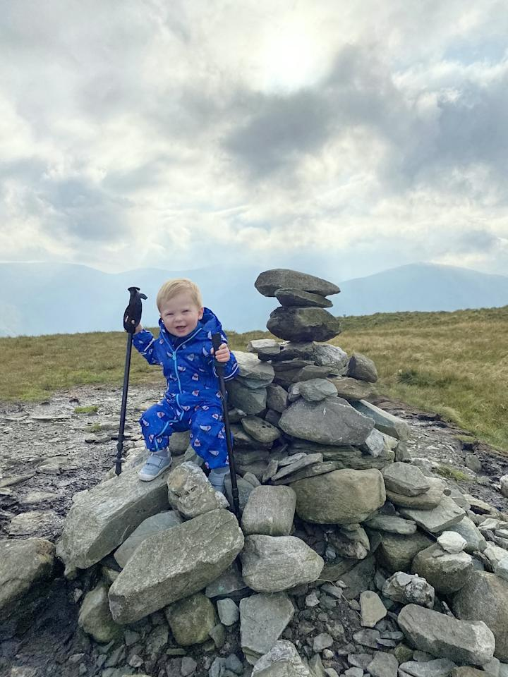 """A baby was on top of the world as he tottered around a mountain summit. Little Joel Russell, 18 months, was carried up the top of Beinn Dubh, near Helensburgh, Argyll and Bute, by his dad, Kyle, 27. The tot, who has been walking since he was a year old, was given walking poles which Kyle made small enough for him to use. Dad-of-two Kyle said: """"He was saying 'where are we going, where are we going?'."""""""