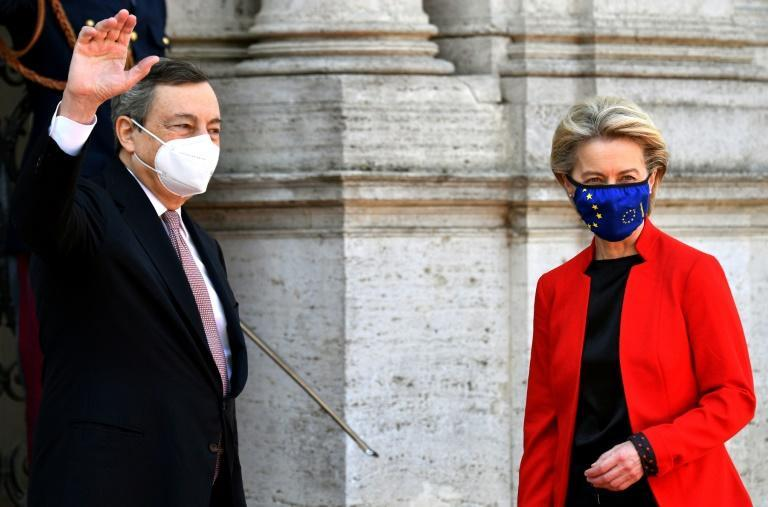 Italian Prime Minister Mario Draghi (left) said 'we must vaccinate the world' at the G20 meeting