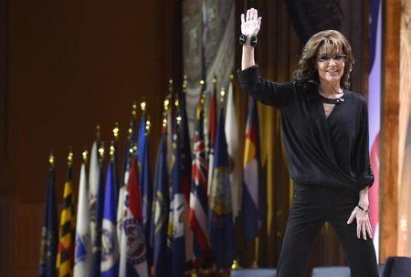 Former Alaska Governor Sarah Palin waves as she departs the stage after remarks to the Conservative Political Action Conference (CPAC) in Oxon Hill, Maryland