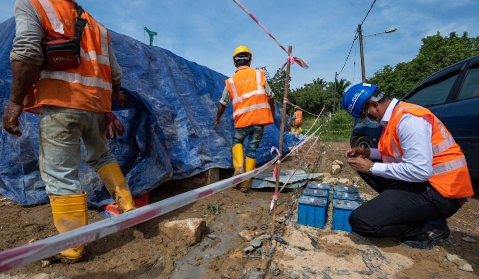 Workers at a China Communications Construction Company site in Malaysia in August. The company has been blacklisted by Trump and dropped by the London Stock Exchange. Photo: Xinhua