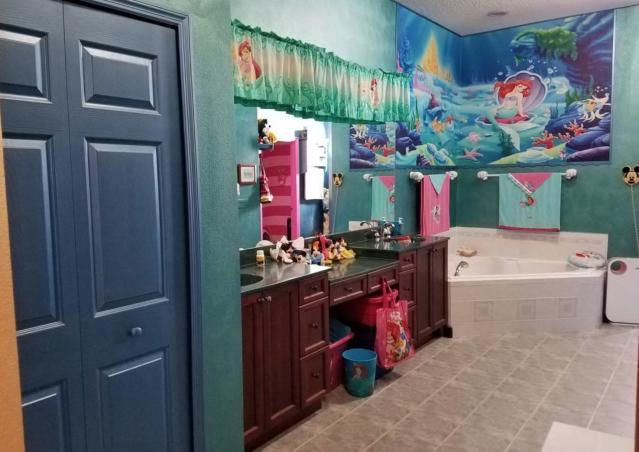 <em>The Little Mermaid</em>'s Ariel and her ocean friends are the stars of this bathroom. (Courtesy: Zillow)