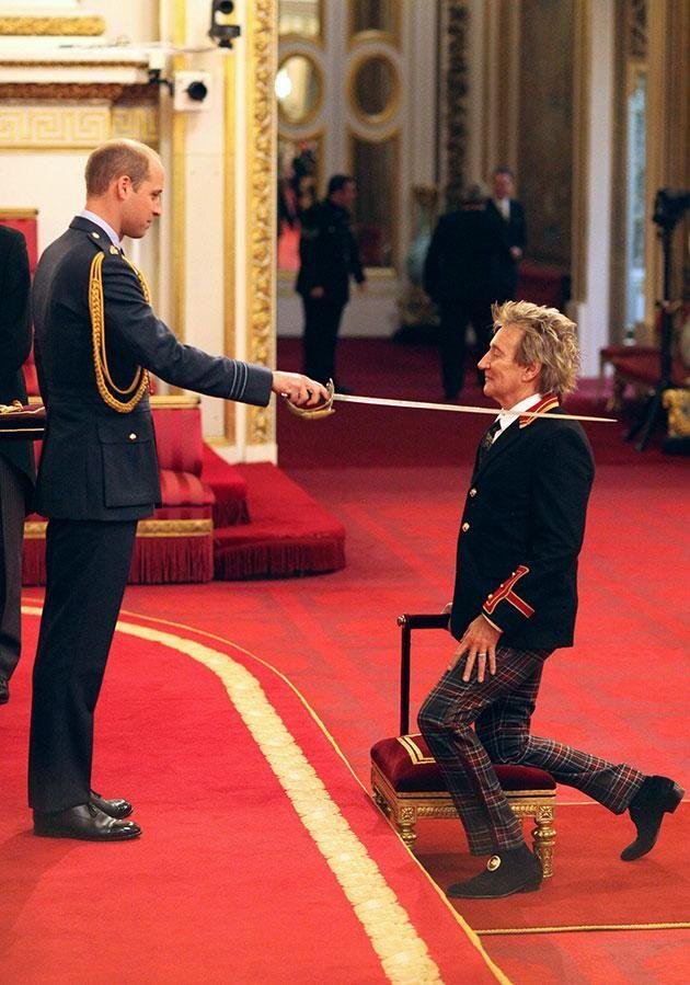 Rod Stewart was knighted by Prince William at Buckingham Palace. Photo: AAP.