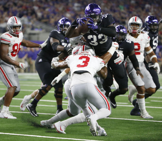 TCU running back Sewo Olonilua (33) scores a touchdown as Ohio State's Damon Arnette Jr. attempts to take him down during the first half of an NCAA college football game in Arlington, Texas, Saturday, Sept. 15, 2018. (AP Photo/Michael Ainsworth)