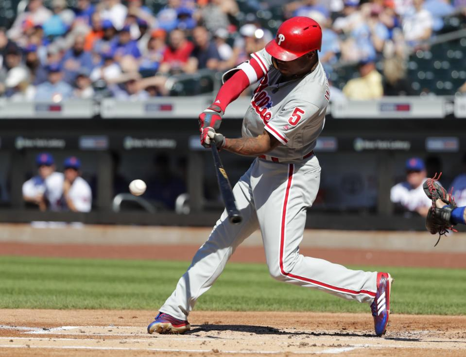 Philadelphia Phillies' Nick Williams (5) hits an RBI-single during the first inning in the first game of a baseball doubleheader against the New York Mets, Monday, July 9, 2018, in New York. (AP Photo/Frank Franklin II)