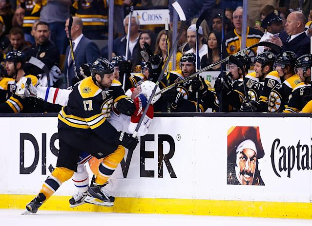 BOSTON, MA - MAY 03: Milan Lucic #17 of the Boston Bruins checks Brendan Gallagher #11 of the Montreal Canadiens against the boards in the third period in Game Two of the Second Round of the 2014 NHL Stanley Cup Playoffs at TD Garden on May 3, 2014 in Boston, Massachusetts. (Photo by Jared Wickerham/Getty Images)
