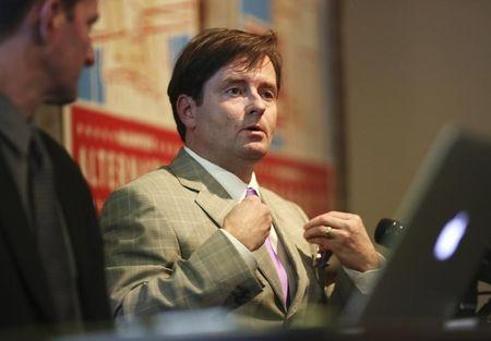 Attorney Christopher Dolan gestures during a news conference in San Francisco