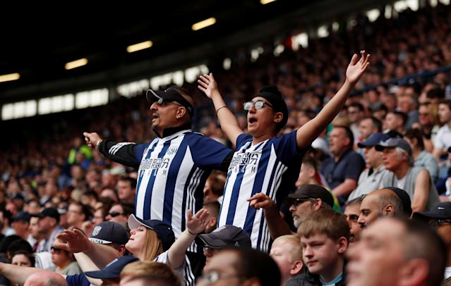 """Soccer Football - Premier League - West Bromwich Albion v Liverpool - The Hawthorns, West Bromwich, Britain - April 21, 2018 West Bromwich Albion fans Action Images via Reuters/Andrew Boyers EDITORIAL USE ONLY. No use with unauthorized audio, video, data, fixture lists, club/league logos or """"live"""" services. Online in-match use limited to 75 images, no video emulation. No use in betting, games or single club/league/player publications. Please contact your account representative for further details."""