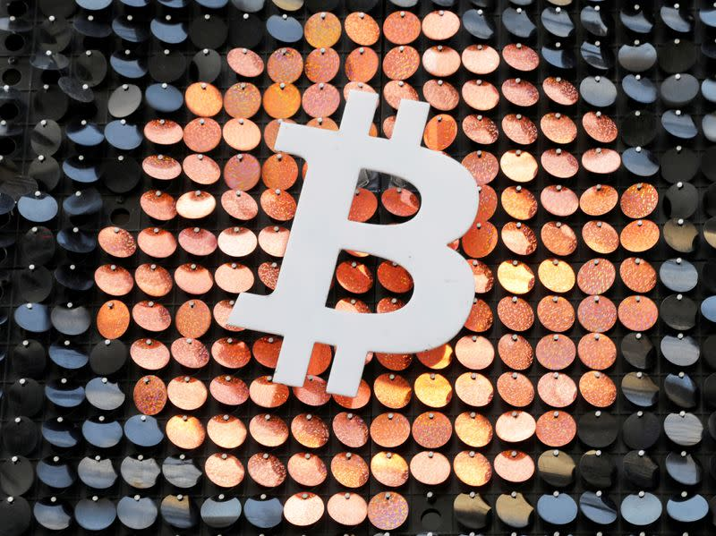 FILE PHOTO: FILE PHOTO: The logo of the Bitcoin digital currency is seen in a shop in Marseille