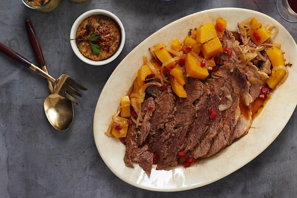 "This braised brisket recipe incorporates white wine instead of the more typical red, and butternut squash instead of potatoes. This makes for a lighter, brighter brisket. <a href=""https://www.epicurious.com/recipes/food/views/white-wine-braised-brisket-butternut-squash-gefilte-manifesto-recipe?mbid=synd_yahoo_rss"" rel=""nofollow noopener"" target=""_blank"" data-ylk=""slk:See recipe."" class=""link rapid-noclick-resp"">See recipe.</a>"