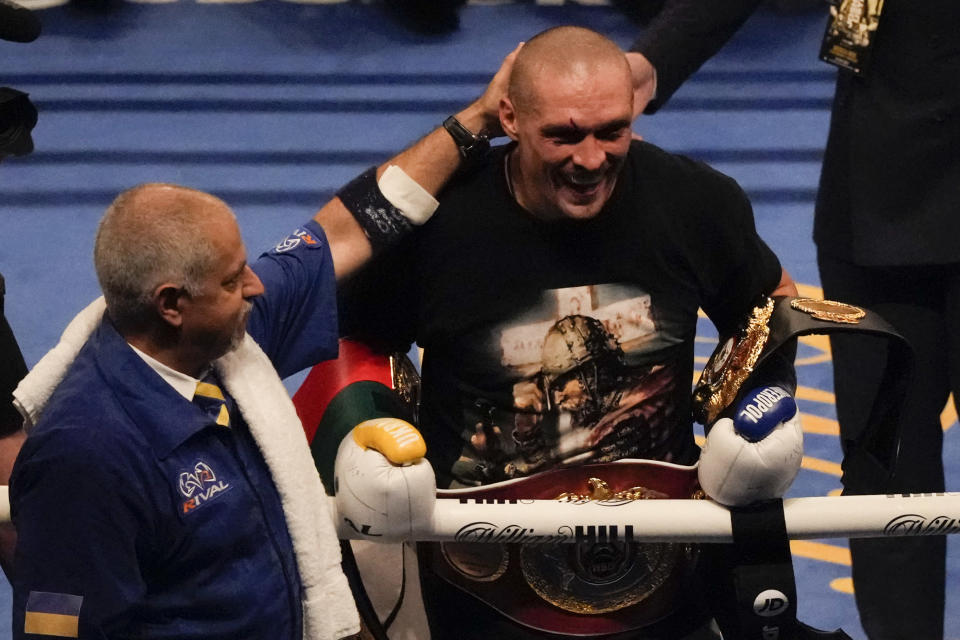 Oleksandr Usyk of Ukraine is congratulated after his unanimous decision victory over Anthony Joshua of Britain in their WBA (Super), WBO and IBF boxing title bout at the Tottenham Hotspur Stadium in London, Saturday, Sept. 25, 2021. (AP Photo/Frank Augstein)