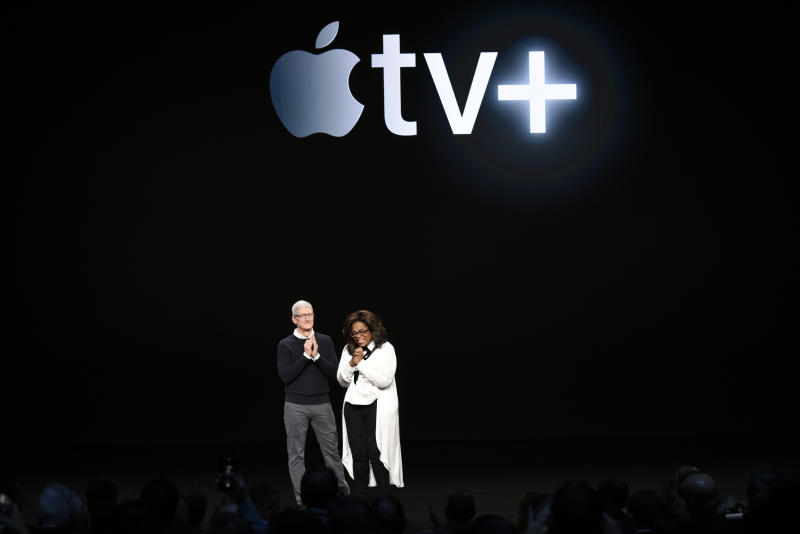 CUPERTINO, CA - MARCH 25: Apple Inc. CEO Tim Cook and Oprah Winfrey stand onstage during a company product launch event at the Steve Jobs Theater at Apple Park on March 25, 2019 in Cupertino, California. Apple announced the launch of it's new video streaming service, unveiled a premium subscription tier to its News app, and announced it would release its own credit card, called Apple Card. (Photo by Michael Short/Getty Images)