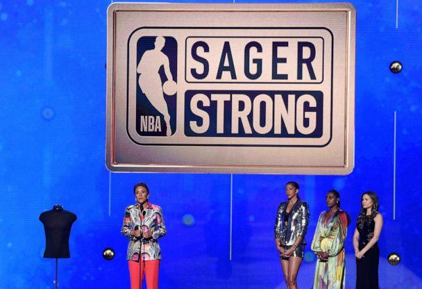 PHOTO: Robin Roberts accepts the Sager strong award at the NBA Awards on June 24, 2019, in Santa Monica, Calif. Looking on from second right are Issa Rae and Candace Parker. (Richard Shotwell/Invision/AP)