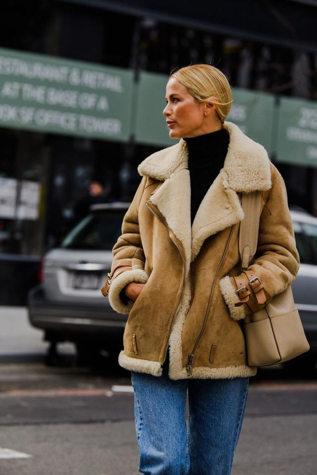 <p>Carolyn Murphy cuddles up in a chic, shearling-lined coat. </p>