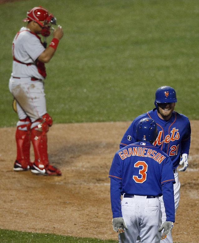 New York Mets first baseman Lucas Duda (21) is greeted by teammate Curtis Granderson (3) after hitting a two-run home run in the fourth inning of a baseball game as Cincinnati Reds catcher Brayan Pena looks down at Citi Field in New York, Friday, April 4, 2014. (AP Photo/Paul J. Bereswill)