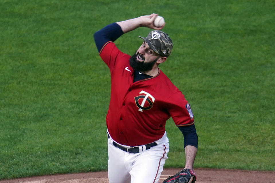 Minnesota Twins pitcher Matt Shoemaker (32) throws to an Oakland Athletics batter during the first inning of a baseball game Friday, May 14, 2021, in Minneapolis. (AP Photo/Jim Mone)