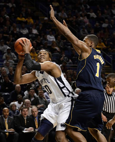 Penn State's Brandon Taylor (10) looks for a shot past Michigan's Glenn Robinson III (1) during the first half of an NCAA college basketball game in State College, Pa., Wednesday, Feb. 27, 2013. (AP Photo/Ralph Wilson)