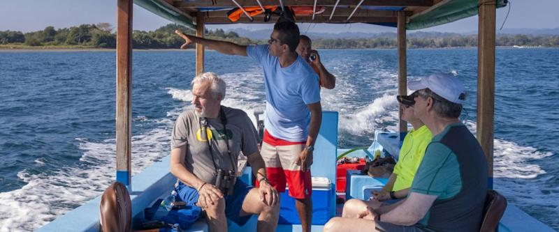 GULFO DULCE, COSTA RICA - FEBRUARY 5, 2016: Eco-tourists on boat tour, near Osa Peninsula.