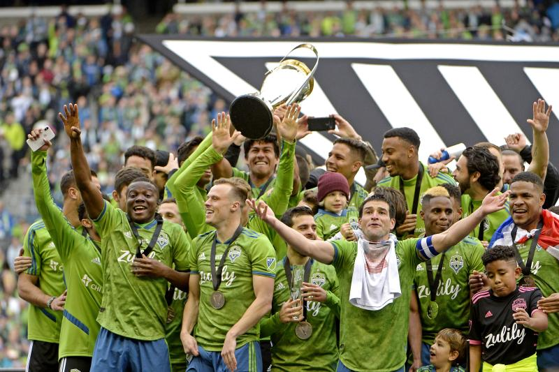 November 10, 2019; Seattle, WA, USA; The Seattle Sounders celebrate with the MLS Cup after beating Toronto FC during the MLS Cup at CenturyLink Field. Mandatory Credit: Troy Wayrynen-USA TODAY Sports