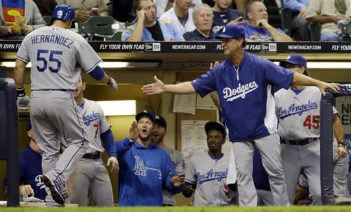 Los Angeles Dodgers manager Don Mattingly, right, congratulates Ramon Hernandez (55) after his home run during the third inning of a baseball game against the Milwaukee Brewers Wednesday, May 22, 2013, in Milwaukee. (AP Photo/Morry Gash)