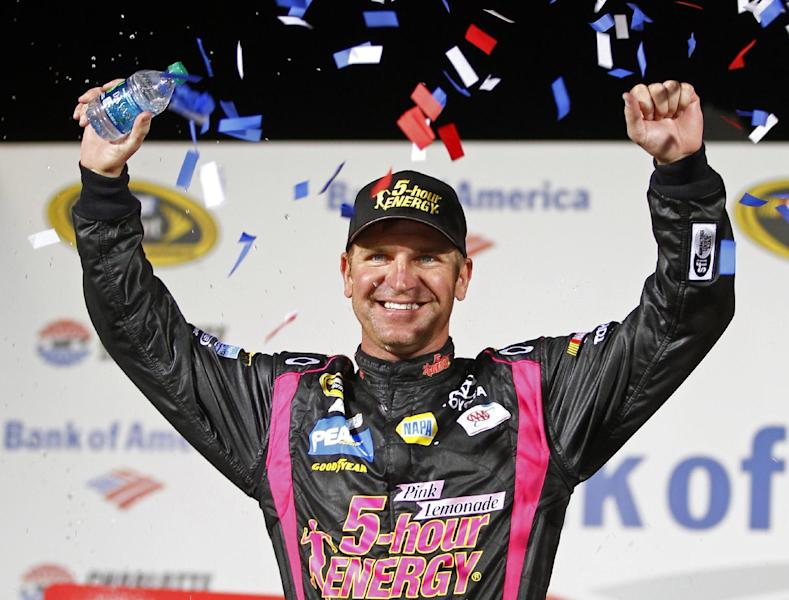 Clint Bowyer celebrates in victory lane after winning the NASCAR Bank of America 500 Sprint Cup series auto race in Concord, N.C., Saturday, Oct. 13, 2012. (AP Photo/Chuck Burton)