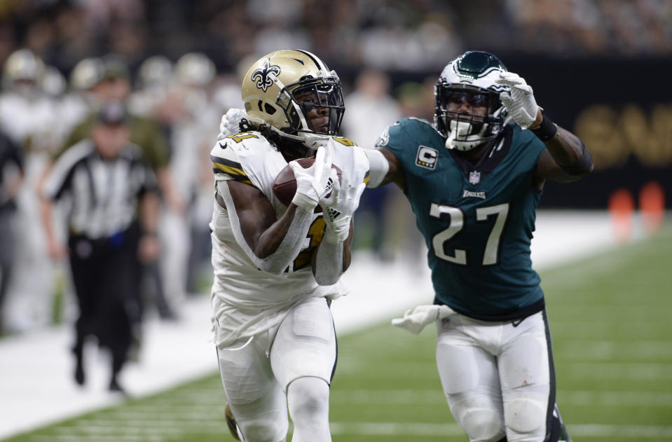 Style points? Saints running back Alvin Kamara pulls in a touchdown reception in front of the Eagles' Malcolm Jenkins late in New Orleans' blowout win. The Saints won 48-7. (AP)