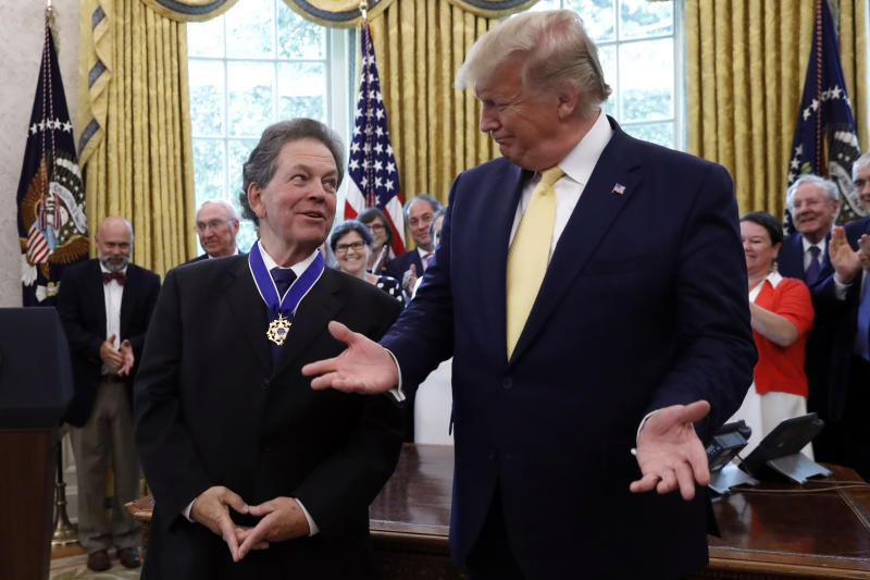President Donald Trump talks with with economist Arthur Laffer after awarding him the Presidential Medal of Freedom Wednesday, June 19, 2019, in the Oval Office of the White House in Washington. (AP Photo/Jacquelyn Martin)