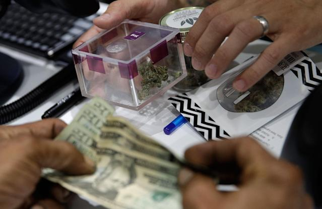 <p>A person buys marijuana at the Essence cannabis dispensary, Saturday, July 1, 2017, in Las Vegas, Nev. (Photo: John Locher/AP) </p>