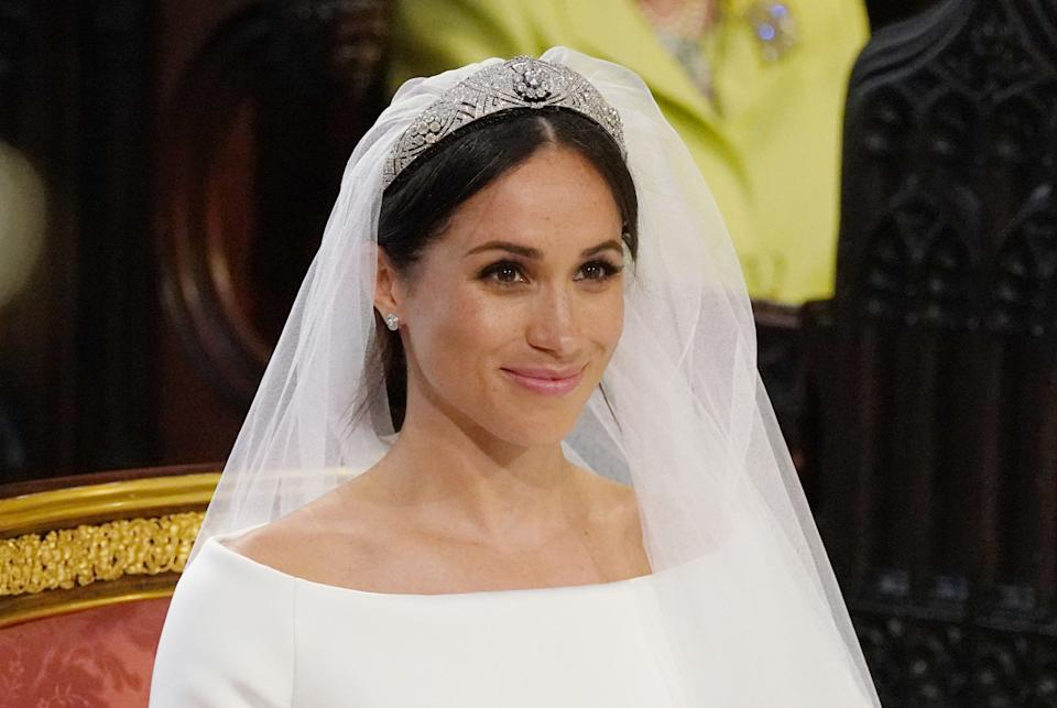 Meghan Markle's veil was held in place with Queen Mary's diamond bandeau tiara, on loan from Queen Elizabeth.
