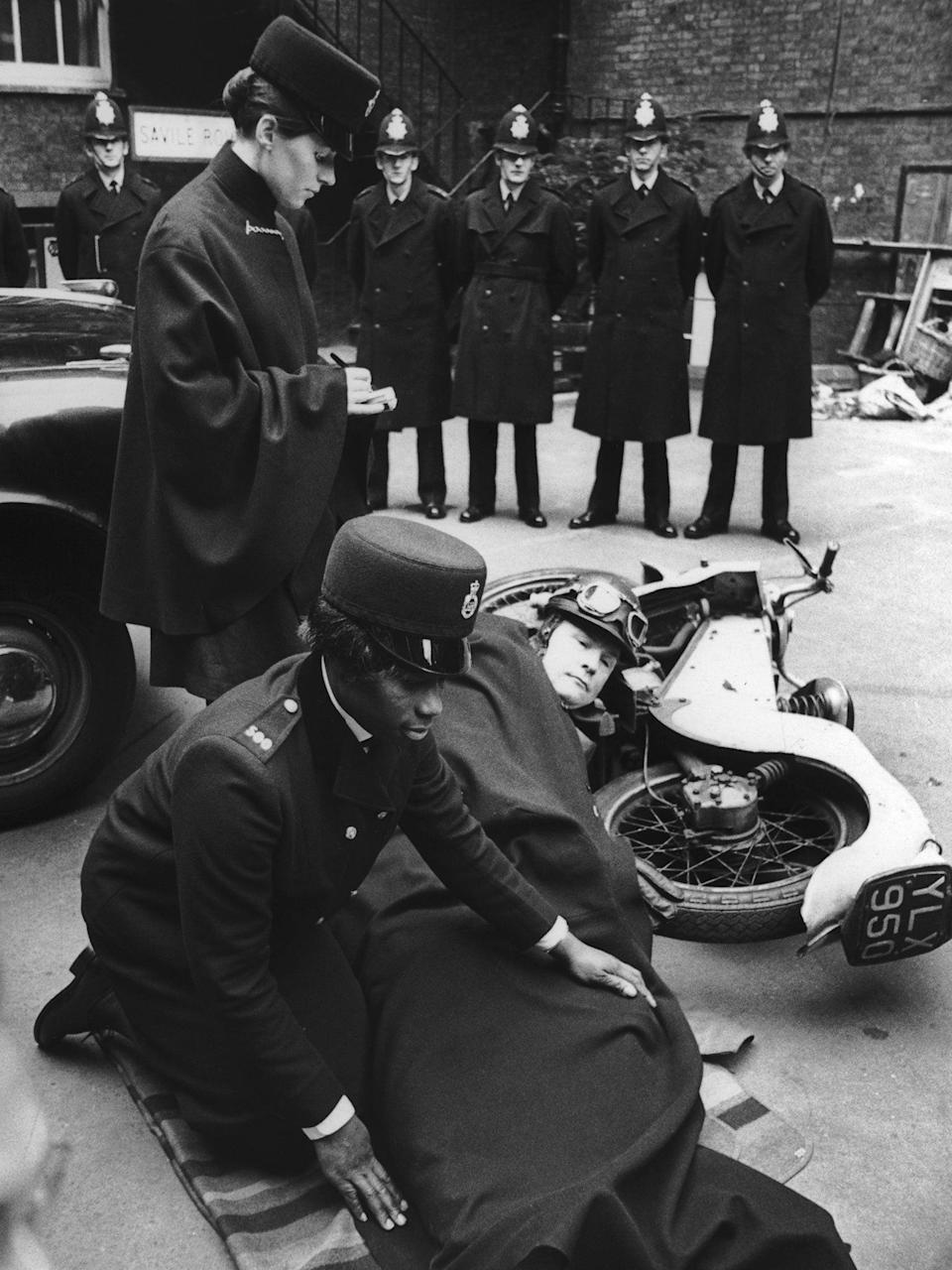 Allen and fellow trainee policewoman Carolyn Marriage learn how to deal with a motorcycle accident (Getty)