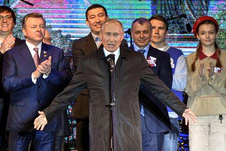 Russian President Vladimir Putin addresses the crowd during a concert marking the fifth anniversary of Russia's annexation of Crimea, in Simferopol March 18, 2019. Yuri Kadobnov/Pool via REUTERS