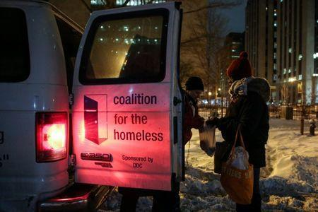 New York City's Coalition for the Homeless delivers food, donated clothing and supplies to homeless people as part of their weekly distribution during winter storm Grayson in Manhattan, New York City, U.S., January 4, 2018. REUTERS/Amr Alfiky