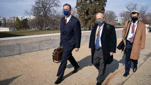 PHOTO: Bruce Castor, left, and David Schoen, center, defense attorneys for former President Donald Trump, walk to the U.S. Capitol on Feb. 10, 2021, in Washington. (Sarah Silbiger/Getty Images)