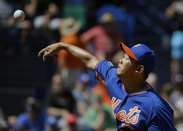 New York Mets starting pitcher Daisuke Matsuzaka throws in the second inning of an exhibition spring training baseball game against the Detroit Tigers, Tuesday, March 18, 2014, in Port St. Lucie, Fla. (AP Photo/David Goldman)