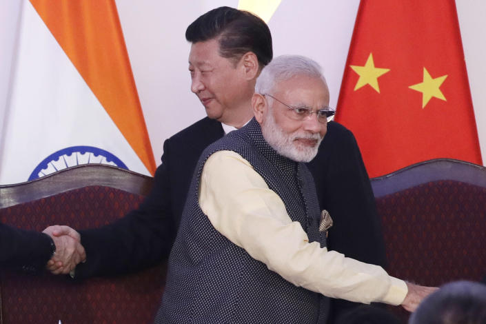 "In this Oct. 16, 2016, file photo, Indian Prime Minister Narendra Modi, front and Chinese President Xi Jinping shake hands with leaders at the BRICS summit in Goa, India. At least three Indian soldiers, including a senior army officer, have been killed in a confrontation with Chinese soldiers along their disputed frontier high in the Himalayas where thousands of troops on both sides have been facing off for over a month, the Indian army said. The army said in a statement Tuesday, June 16, 2020, that a ""violent faceoff"" took place in Galwan valley in the Ladakh region on Monday night ""with casualties on both sides."" (AP Photo/Manish Swarup, File)"