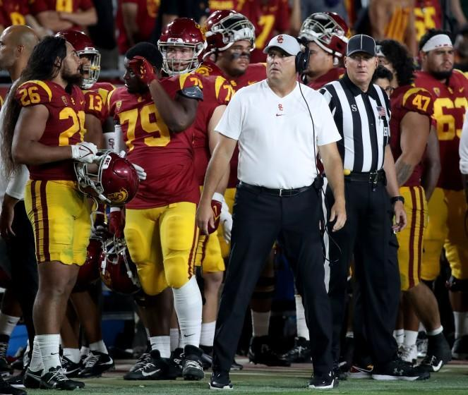 LOS ANGELES, CALIF. - SEP 11, 2021. USC head coach Clay Helton looks at the scoreboard.