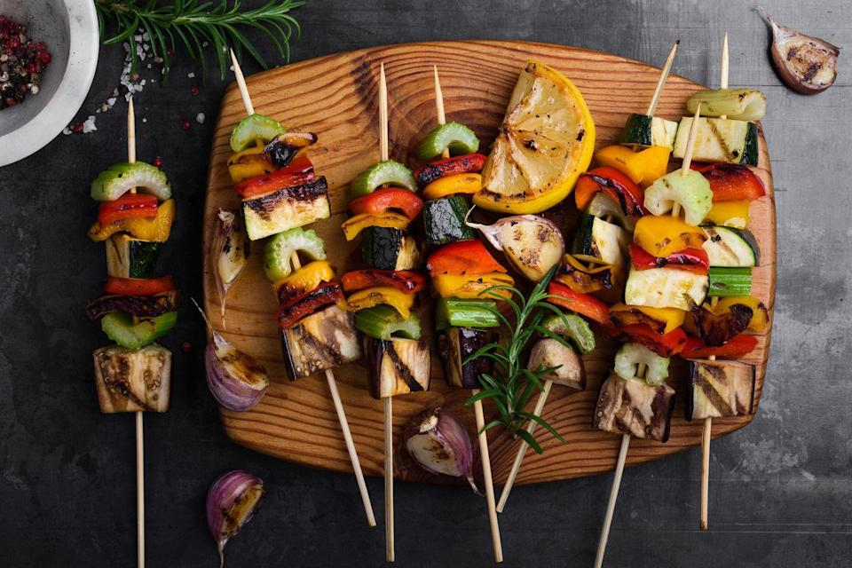 """<p>Although there's nothing wrong with putting vegetables directly on the grill grates, putting them on a skewer makes things easier. </p><p>""""Preparing veggie skewers is a more convenient way to grill vegetables as you don't have to worry about sliced vegetables falling between the grill grates,"""" Jessica Randhawa, the head chef, recipe curator, photographer, and writer behind <a href=""""https://theforkedspoon.com/"""" rel=""""nofollow noopener"""" target=""""_blank"""" data-ylk=""""slk:The Forked Spoon"""" class=""""link rapid-noclick-resp"""">The Forked Spoon</a> tells Woman's Day. </p><p>Randhawa recommends soaking the skewers for at least 15 minutes so that they don't burn and you get the best flavor. She also says you should, """"never place cherry tomatoes on the same veggie skewer as red onion. You'll end up with either delicious tomatoes and raw red onion or melted tomatoes and perfect red onion."""" </p>"""