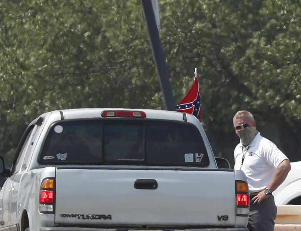 A race fan flying a Confederate battle flag passes through a checkpoint as he enters Talladega Superspeedway for a NASCAR Cup Series auto race in Talladega, Ala., Sunday, June 21, 2020. (AP Photo/John Bazemore)