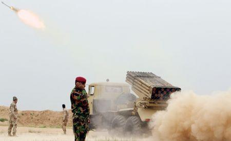 Iraqi soldiers fire a rocket toward Islamic State militants on the outskirt of the Makhmour south of Mosul