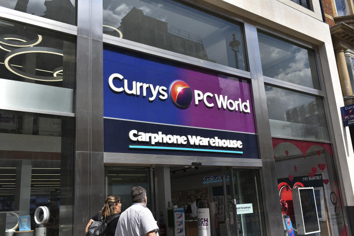 People walk past a Carphone store in Central London, on July 31, 2018. Dixons Carphone has apologised to all of its customers after revealing that a 2017 data breach affected personal data held in an additional 8.8 million customer records. The admission is the second revelation related to the data breach in six weeks and the third since 2015. (Photo by Alberto Pezzali/NurPhoto via Getty Images)