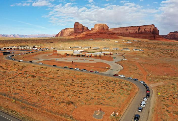 Vehicles line up for testing outside of the Monument Valley Health Center in Oljato-Monument Valley, Utah, on Apr. 17, 2020. | Kristin Murphy/The Deseret News–AP