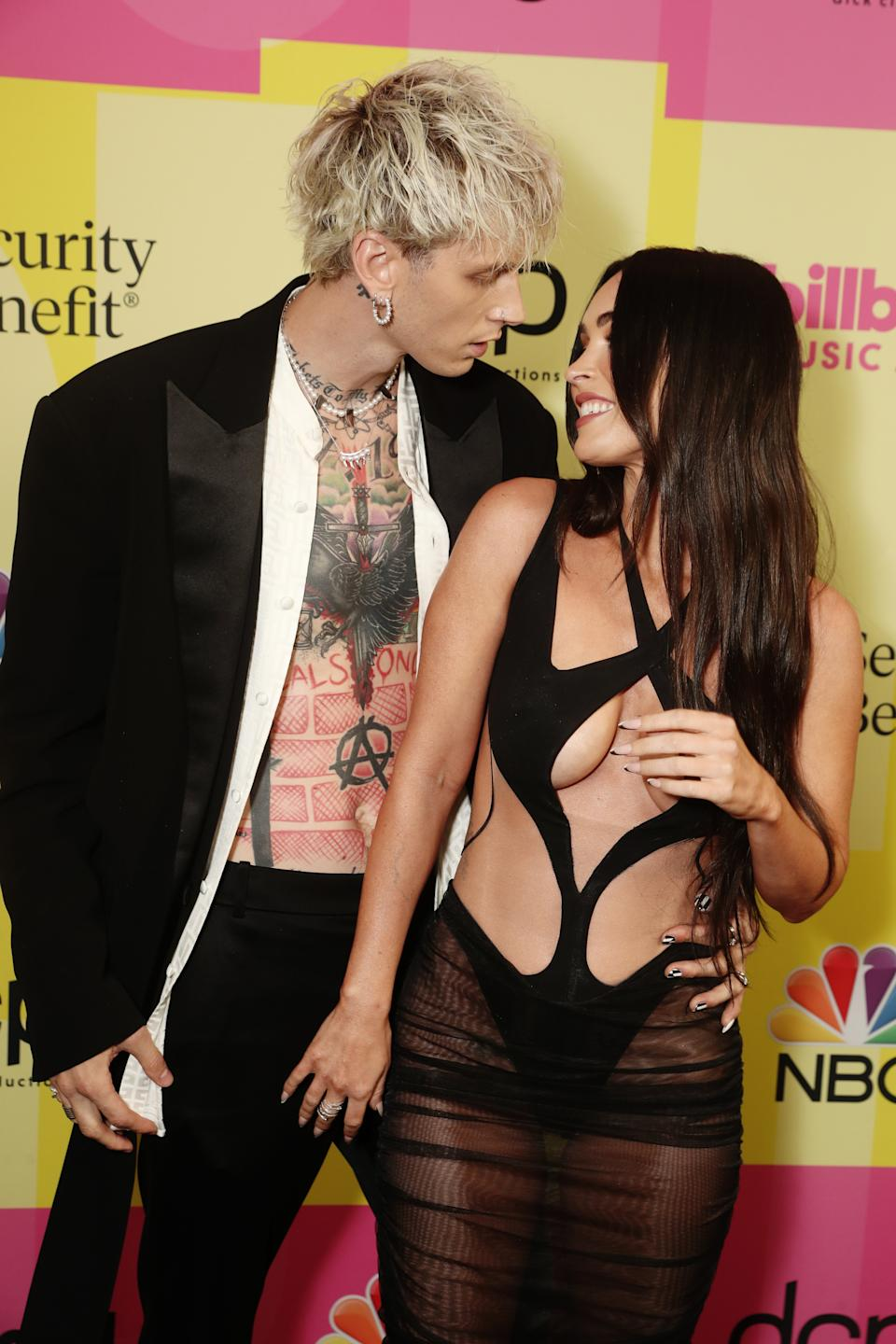 LOS ANGELES, CA - MAY 23:  2021 BILLBOARD MUSIC AWARDS -- Pictured: (l-r) Machine Gun Kelly and Megan Fox arrive to the 2021 Billboard Music Awards held at the Microsoft Theater on May 23, 2021 in Los Angeles, California. --  (Photo by Todd Williamson/NBC/NBCU Photo Bank via Getty Images)