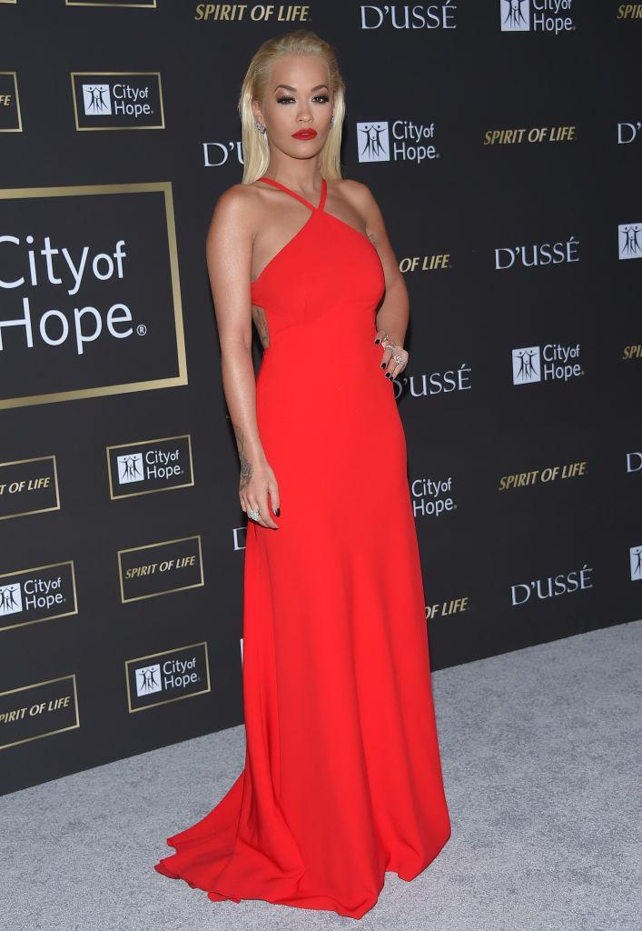 <p>On October 11, singer Rita Ora donned a floor-sweeping red dress and co-ordinating lipstick for the annual City of Hope Gala. <em>[Photo: Getty]</em> </p>