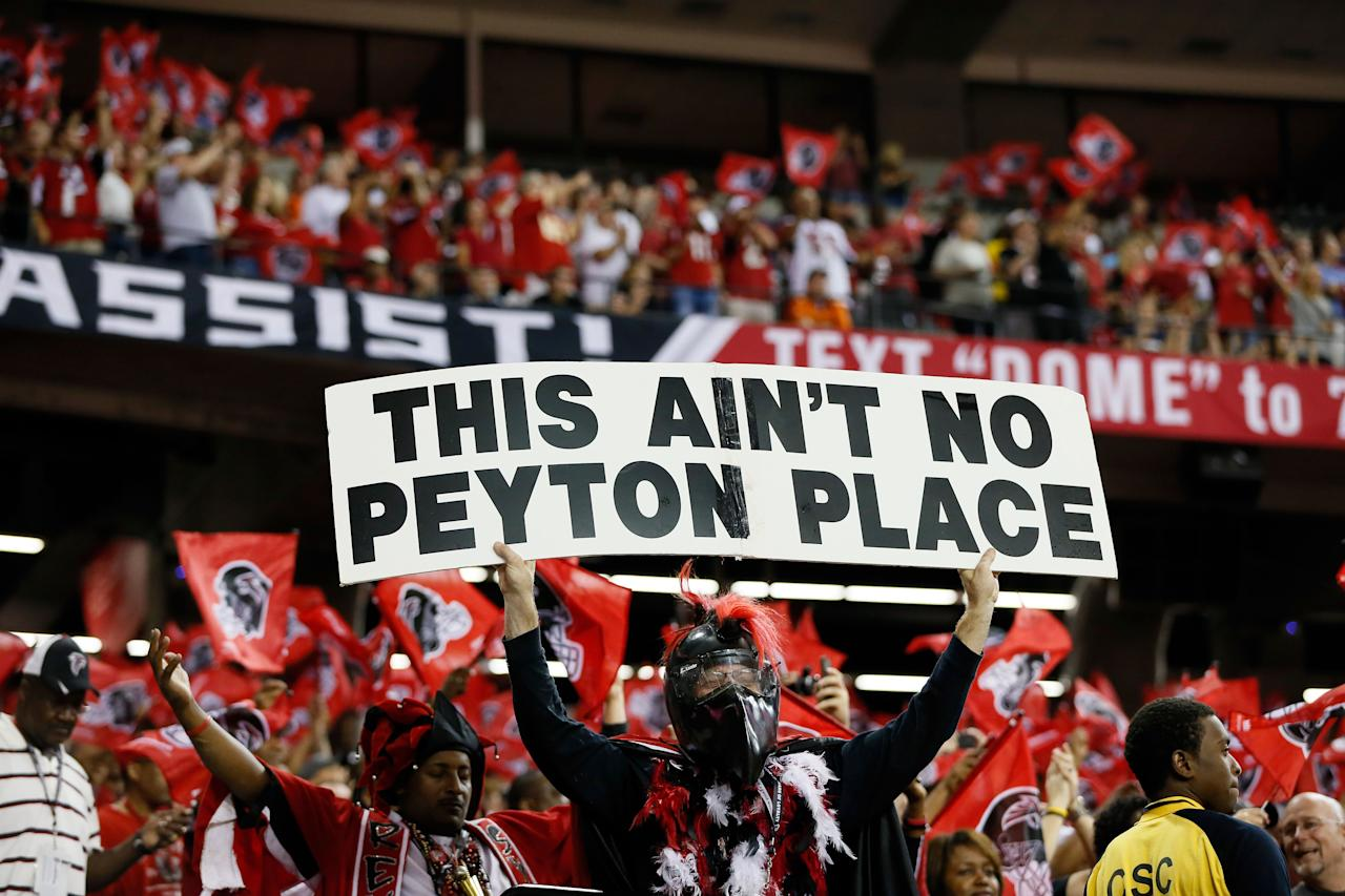 """ATLANTA, GA - SEPTEMBER 17:  An Atlanta Falcons fan holds a sign up that reads, """"This Ain't No Peyton Place."""" prior to a game between the Atlanta Falcons and the Denver Broncos at the Georgia Dome on September 17, 2012 in Atlanta, Georgia.  (Photo by Kevin C. Cox/Getty Images)"""