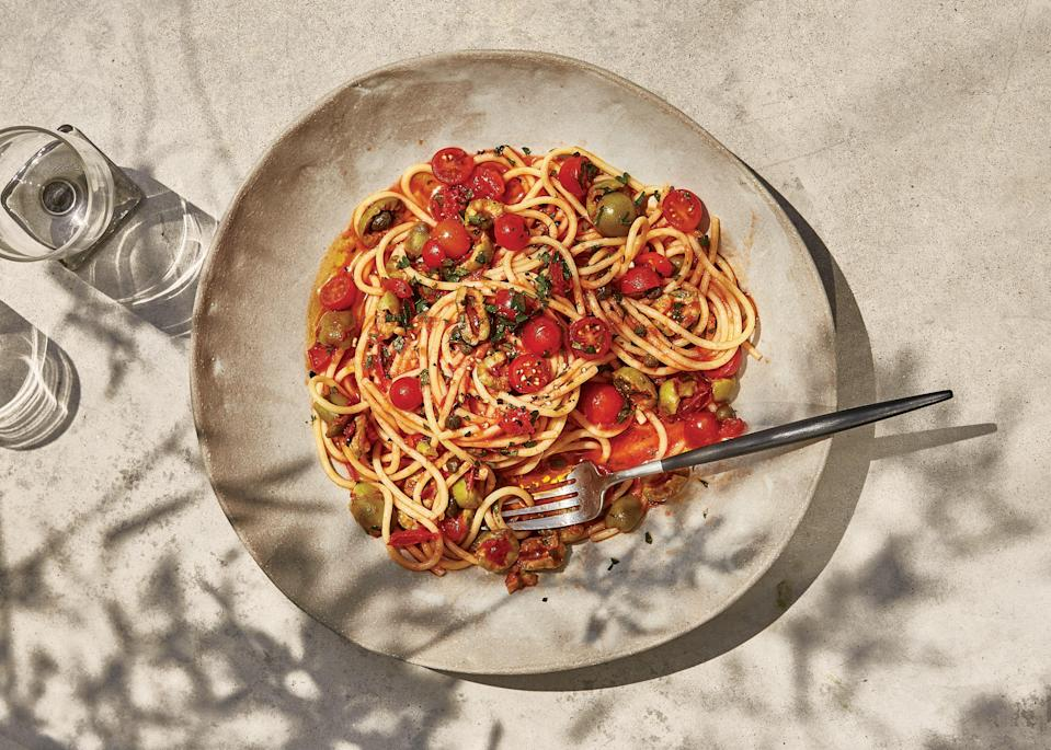 """Tomato seeds and membranes can be a bit bitter, which is why we remove them from this uncooked preparation—it also prevents the sauce from being watery. <a href=""""https://www.epicurious.com/recipes/food/views/spaghetti-with-no-cook-puttanesca?mbid=synd_yahoo_rss"""" rel=""""nofollow noopener"""" target=""""_blank"""" data-ylk=""""slk:See recipe."""" class=""""link rapid-noclick-resp"""">See recipe.</a>"""