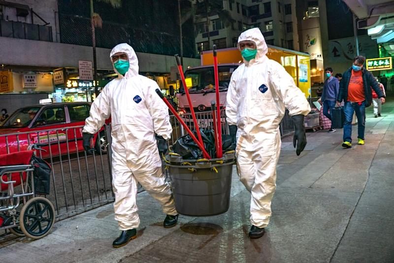 Workers from the Department of Health in Hong Kong | Anthony Kwan/Getty Images