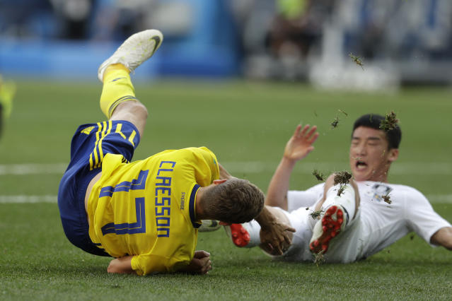 Sweden's John Guidetti, left, is tackled by South Korea's Kim Min-woo conceding a penalty kick for Sweden during the group F match between Sweden and South Korea at the 2018 soccer World Cup in the Nizhny Novgorod stadium in Nizhny Novgorod, Russia, Monday, June 18, 2018. (AP Photo/Petr David Josek)