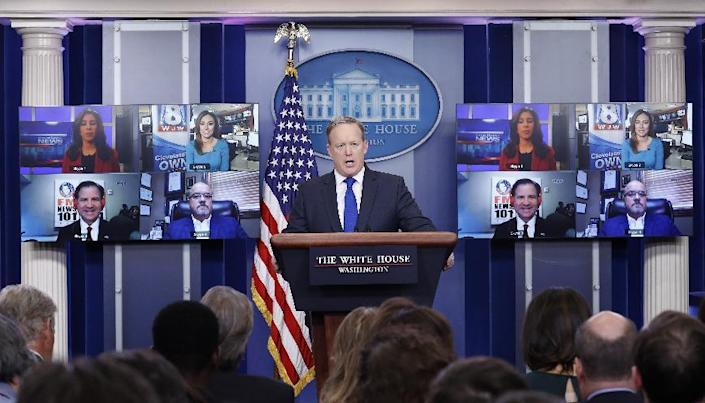 White House press secretary Sean Spicer takes a questions from reporters displayed on screens using Skype during the daily news briefing at the White House, in Washington, Wednesday, Feb. 1, 2017. (AP Photo/Carolyn Kaster)