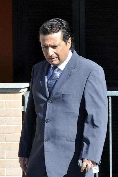 Former captain of the Costa Concordia luxury cruise ship Francesco Schettino leaves his house to attend a closed-door hearing for the 2012 grounding off Tuscany that killed 32 people, in Grosseto, Italy, Tuesday, May 14, 2013. Prosecutors want Capt. Schettino to stand trial for alleged manslaughter, causing a shipwreck and abandoning the ship before all passengers had been evacuated. (AP Photo/Giacomo Aprili)