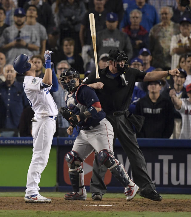 Los Angeles Dodgers' Cody Bellinger reacts after striking out to end the 15th inning in Game 3 of the World Series baseball game against the Boston Red Sox on Friday, Oct. 26, 2018, in Los Angeles. (AP Photo/Mark J. Terrill)